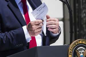 President Donald Trump removes and unfolds his notes as he speaks with the press, during a Made in America showcase on the South Lawn of the White House, Monday, July 15, 2019, in Washington. (AP Photo/Alex Brandon)