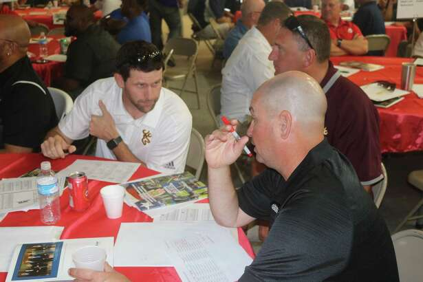 Deer Park head football coach Austin Flynn conducts another meeting at the District 21-6A table during last week's Referee Selection Day.