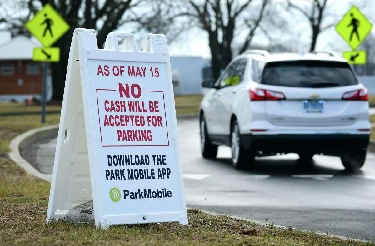 Signs are posted at Calf Pasture Beach Friday, February 9, 2019, warning visitors that the beach attendants will not be accepting cash this season at the popular park in Norwalk, Conn. The Common Council voted in January to enter into a $180,000 contract with Port Chester-based LAZ Parking to steamline parking management at Calf Pasture Beach, Shady Beach, Taylor Farm, Veterans Park and Cranbury Park for the 2019 season. Non-residents will be able to purchase season passes using an app or, for those not technologically inclined, by phone or by swiping a credit or debit card at the entrance to the parks.