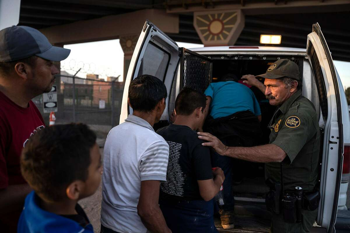 (FILES) In this file photo taken on May 16, 2019 migrants, mostly from Central America, board a van which will take them to a processing center in El Paso, Texas. - The Trump administration moved on July 15, 2019 to block most migrants who cross the US southern border after passing through Mexico from seeking asylum.A new rule redefining asylum eligibility -- to take effect on Tuesday -- is the latest attempt to stem the flow of undocumented migrants into the country, and comes amid White House frustration at Congress's failure to change asylum laws. (Photo by Paul Ratje / AFP)PAUL RATJE/AFP/Getty Images