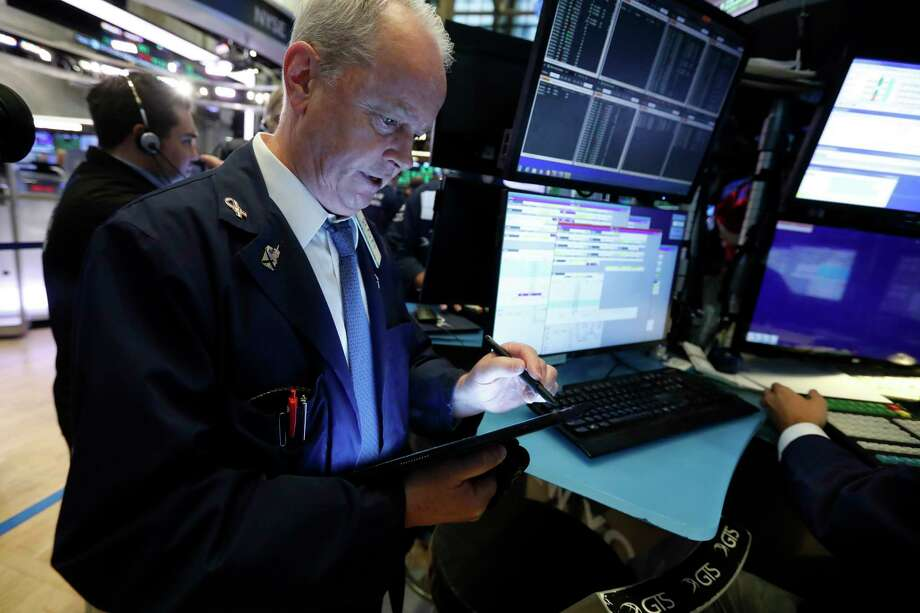 FILE - In this July 1, 2019, file photo trader James Riley works on the floor of the New York Stock Exchange. The U.S. stock market opens at 9:30 a.m. EDT on Monday, July 15. (AP Photo/Richard Drew, File) Photo: Richard Drew / Copyright 2019 The Associated Press. All rights reserved.