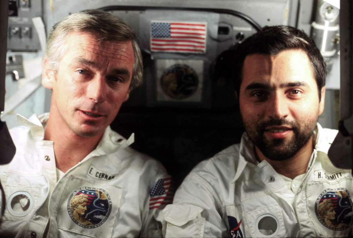 """Astronaut Gene Cernan (left) and scientist-astronaut Harrison H. """"Jack"""" Schmitt are show aboard the Apollo 17 spacecraft during the final lunar landing mission in NASA's Apollo program in December 1972. Astronaut Ronald E. Evans, command module pilot, took the picture. Cernan was the mission commander. Schmitt served as the lunar module pilot. Apollo 17 launched Dec. 7, 1972, and the crew returned to Earth on Dec. 19, 1972."""