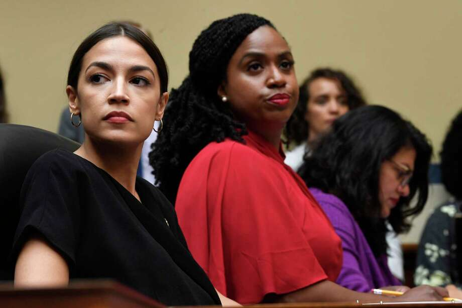 Rep. Alexandria Ocasio-Cortez, D-N.Y., left, Rep. Ayanna Pressley, D-Mass., center, and Rep. Rashida Tlaib, D-Mich., right, attend a House Oversight Committee hearing on Capitol Hill in Washington, Monday, July 15, 2019, on White House counselor Kellyanne Conway's violation of the Hatch Act. (AP Photo/Susan Walsh) Photo: Susan Walsh / Copyright 2019 The Associated Press. All rights reserved.