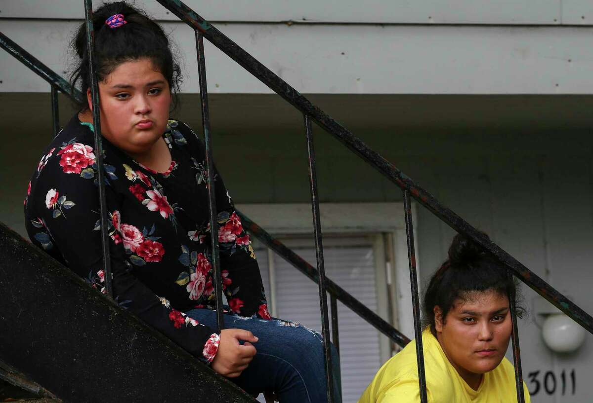 Joana Garcia, left, and Casandra Lopez listen as Kaylin Garcia talks to reporters about the raid conducted by ICE agents early Monday morning at the El Paraiso Apartments complex Monday, July 15, 2019, in Houston.