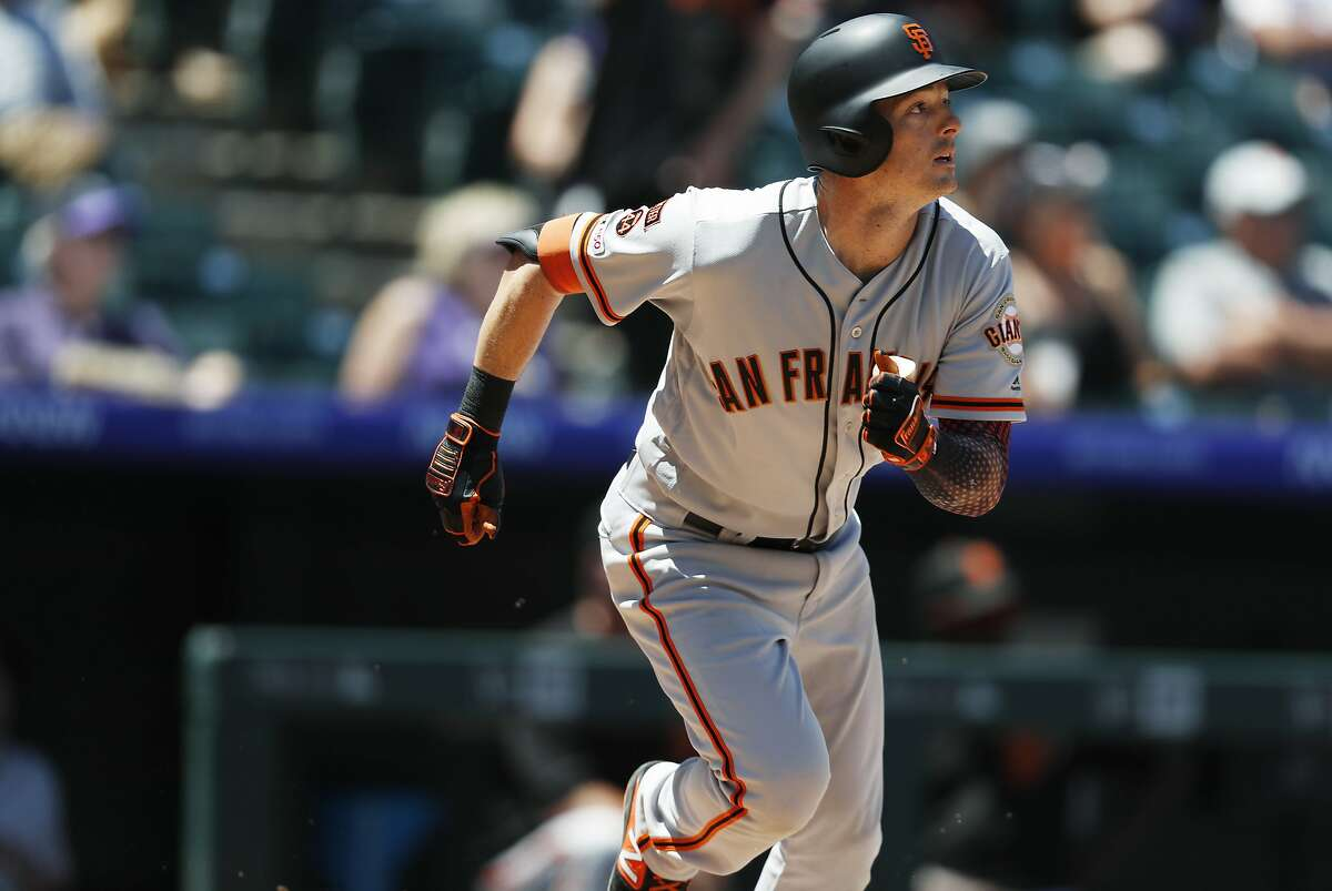 San Francisco Giants' Mike Yastrzemski follows the flight of his double to drive in two runners off Colorado Rockies starting pitcher German Marquez in the third inning of a baseball game Monday, July 15, 2019, in Denver.