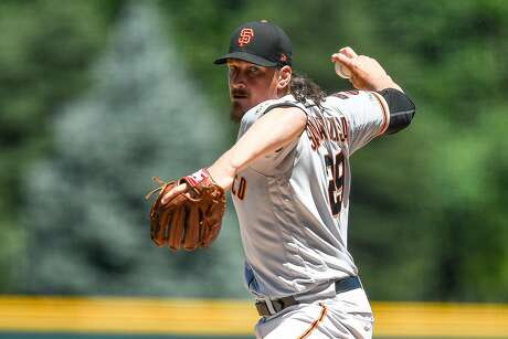 DENVER, CO - JULY 15:  Jeff Samardzija #29 of the San Francisco Giants pitches against the Colorado Rockies in the first inning during game one of a doubleheader at Coors Field on July 15, 2019 in Denver, Colorado. (Photo by Dustin Bradford/Getty Images) Photo: Dustin Bradford / Getty Images