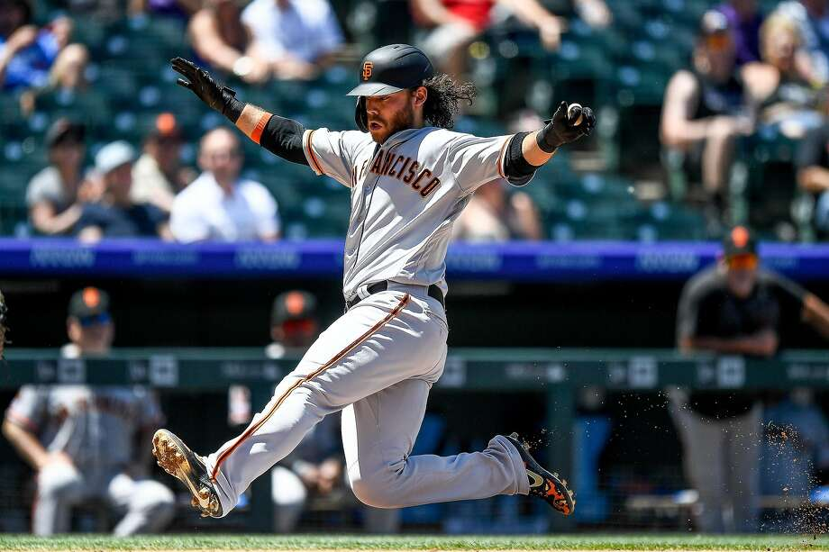 DENVER, CO - JULY 15:  Brandon Crawford #35 of the San Francisco Giants slides safely into home with a third inning run against the Colorado Rockies during game one of a doubleheader at Coors Field on July 15, 2019 in Denver, Colorado. (Photo by Dustin Bradford/Getty Images) Photo: Dustin Bradford / Getty Images