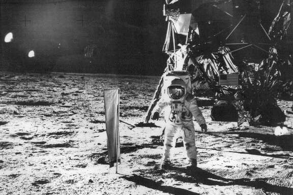 Apollo 11 astronaut Buzz Aldrin beside the deployed Solar Wind Composition on the moon, photo released July 31, 1969 by the Space Center, Houston TX,   NASA photo distributed via Associated Press