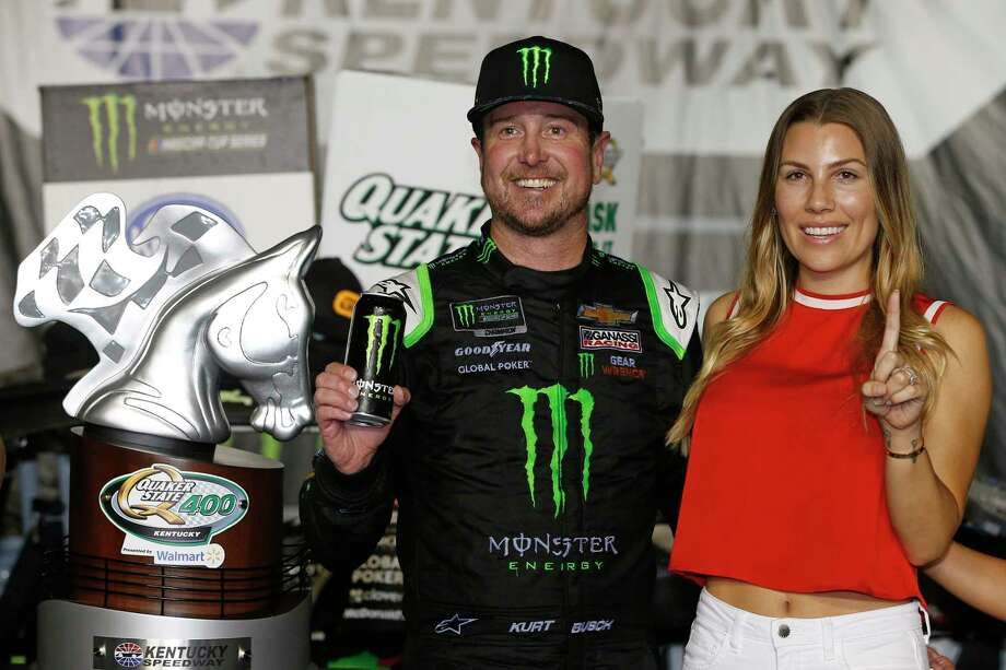 SPARTA, KENTUCKY - JULY 13: Kurt Busch, driver of the #1 Monster Energy Chevrolet, celebrates in Victory Lane with his wife, Ashley, after winning the Monster Energy NASCAR Cup Series Quaker State 400 Presented by Walmart at Kentucky Speedway on July 13, 2019 in Sparta, Kentucky. (Photo by Brian Lawdermilk/Getty Images) Photo: Brian Lawdermilk / 2019 Getty Images