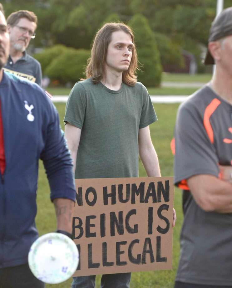 "Ernie Johnson, of Bethel, listens to a speech at the ""Light for Liberty:A Vigil to End Human Detention Camps"" vigil held in Bethel and across the world. Friday evening. Friday, July 12, 2019, in Bethel, Conn. Photo: H John Voorhees III / Hearst Connecticut Media / The News-Times"