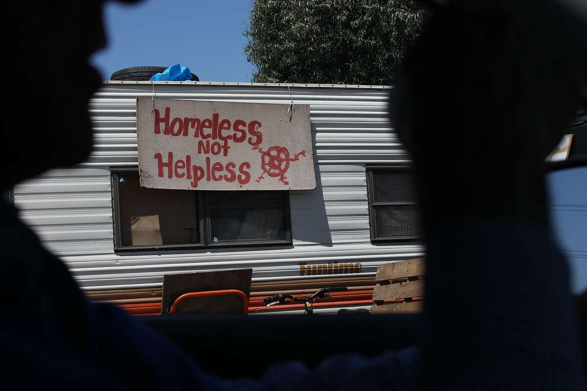 """Oakland City Councilman Noel Gallo drives through the Community of Grace, located outside of The Home Depot in Oakland, Calif., on Tuesday, June 4, 2019. The Home Depot, located at 4000 Alameda Ave., may pull out of its Oakland store unless the city can curb the crime, tent and RV encampments that have overtaken the area. """"That's the message we got at a meeting with Home Depot representatives,"""" said Oakland City Councilman Noel Gallo, whose district includes the big box hardware store at 4000 Alameda Ave."""
