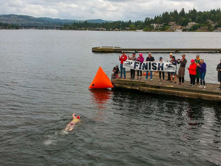 Stephanie Zimmerman reaches the finish of her 20-kilometer race around Mercer Island. This Saturday, she'll take to the Puget Sound. Photo: Todd Mason