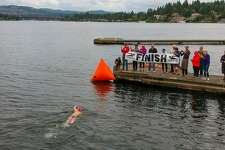 Stephanie Zimmerman reaches the finish of her 20-kilometer race around Mercer Island. This Saturday, she'll take to the Puget Sound.