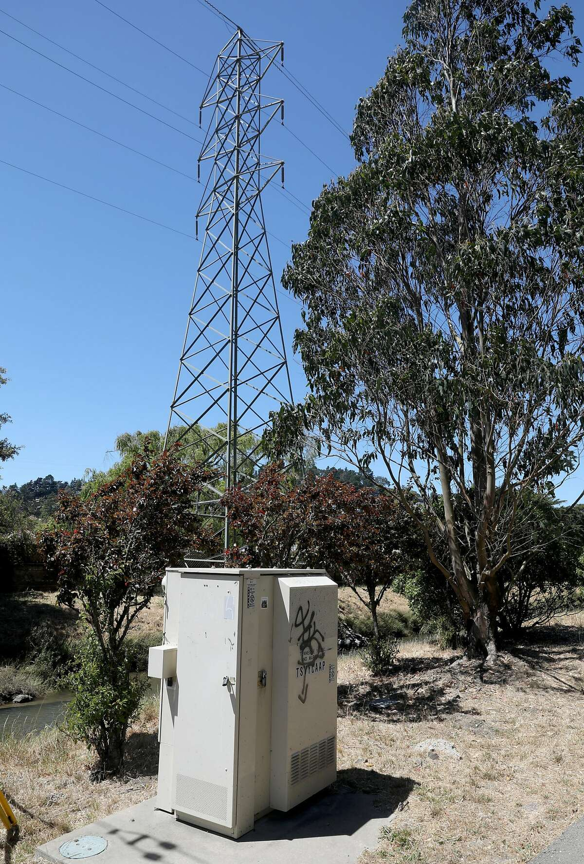 Marin power line seen behind a ATT underground power line at Tennessee Valley Rd. @ Marin Ave. next to the Charles F. McGlashan multiuse pathway on Monday, July 15, 2019 in Mill Valley, Calif.