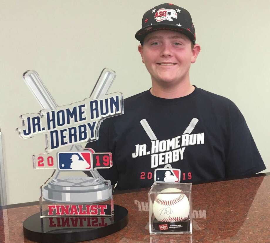 Conroe student Karsen Luther poses with his MLB Jr. Home Run Derby finalist trophy along with an autographed baseball from Los Angeles Angels outfielder Mike Trout. Photo: Rob Tate / Staff Photographer