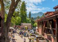 The Mill Valley Lumber Yard, an historic shopping village, renovated and re-purposed in 2017-2018 into retail shops plus a restaurant and bakery, with an acre of outdoor space along the creek.    Photo courtesy Ja n Mathews, Mill Valley Lumber Yard