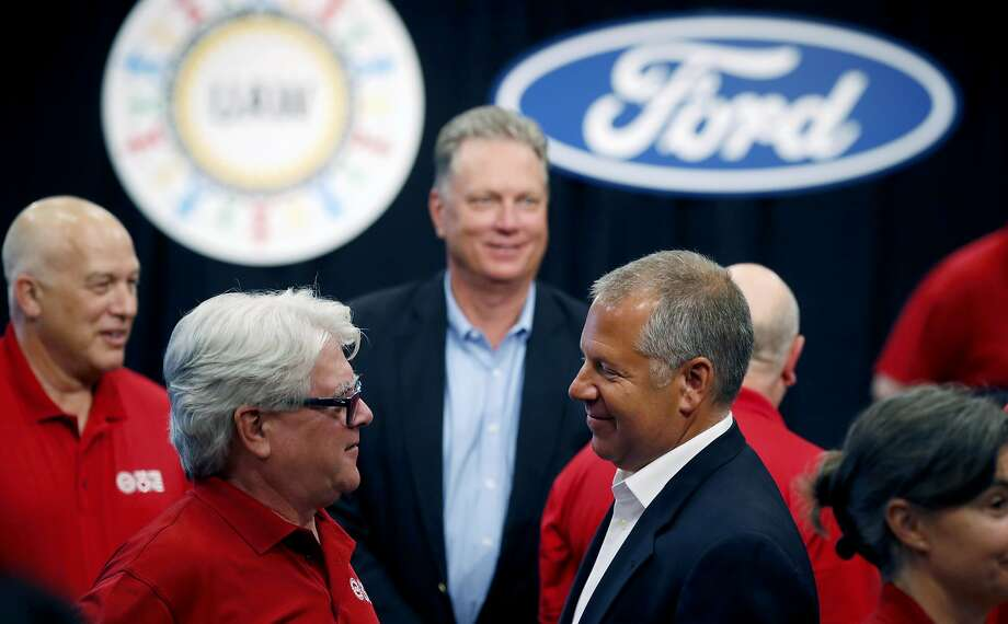 United Auto Workers Local 600 President Bernie Ricke, left, talks with Ford Motor Co., President Automotive Joseph R. Hinrichs after opening contract talks Monday, July 15, 2019, in Dearborn, Mich. (AP Photo/Carlos Osorio) Photo: Carlos Osorio, Associated Press