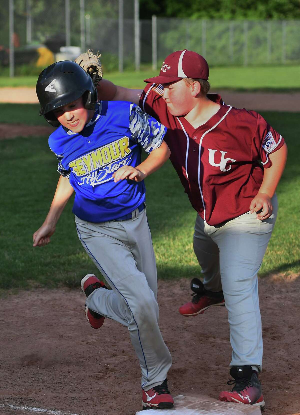 Seymour's Nate Nevers is forced out at first by Union City first baseman Billy Morran for the final out of the fourth inning on Monday.