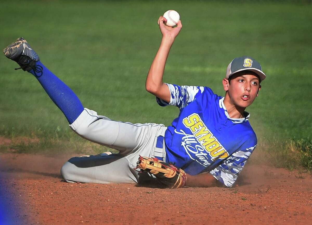 Seymour shortstop Robbie Carrafiello throws to second after making a diving stop in the first inning of the District 3 Little League championship game versus Union City on Monday.