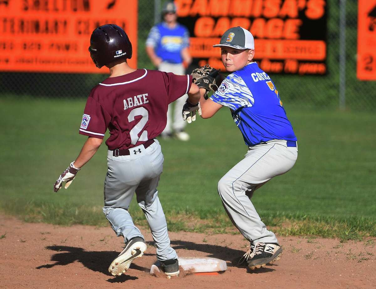 Seymour second baseman Anthony Cortello looks to turn two after getting the force out on Union City's Damon Abate in the first inning of the District 3 Little League championship in Shelton on Monday.