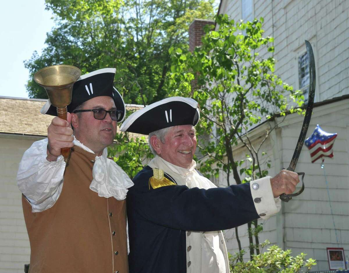 Ridgefield residents Mark Blanford and Don Daughters prepare to slice the ceremonial watermelon after reading the Declaration of Independence at the  Keeler Tavern Museum's WatermelonFest.