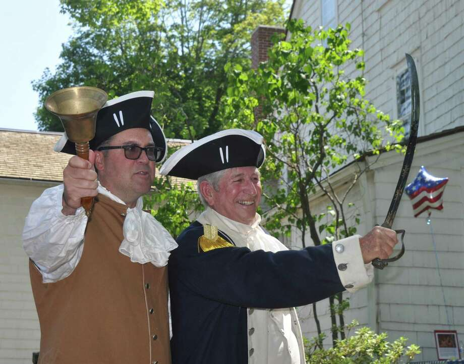 Ridgefield residents Mark Blanford and Don Daughters prepare to slice the ceremonial watermelon after reading the Declaration of Independence at the  Keeler Tavern Museum's WatermelonFest. Photo: Macklin Reid / Connecticut Hearst Media