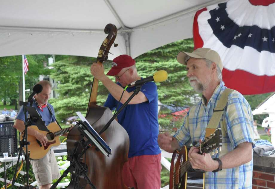 The Angry O'Haras will perform a free outdoor concert Aug. 16, at 2 p.m. on the grounds of the Keeler Tavern Museum and History Center. The band is made up of Chris Anderson on the guitar, left, Mike Crezcenzo on the bass, middle, and Gerry O'Hara on the guitar, right. Photo: Macklin Reid / Hearst Connecticut Media
