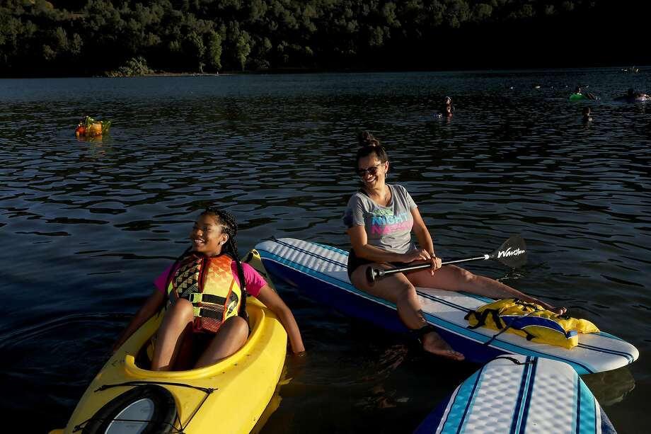 Hot temperatures are in store for Northern California this weekend. In this file photo, Grace Allen, 14, and her mother, Alicha Allen, 41, of Tracy, enjoy their afternoon at Del Valle Regional Park in Livermore, Calif., on Saturday, July 13, 2019.  Photo: Yalonda M. James / The Chronicle