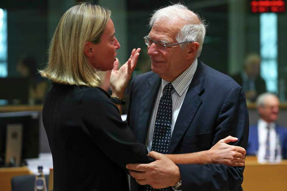 European Union foreign policy chief Federica Mogherini, left, talks to Spain's Foreign Minister Josep Borrell during a European Foreign Affairs meeting at the European Council headquarters in Brussels, Monday, July 15, 2019. European Union nations were looking to deescalate tensions in the Persian Gulf area on Monday and call on Iran to stick to the 2015 nuclear deal, despite the pullout of the United States from the accord and the re-imposition of U.S. sanctions on Tehran. (AP Photo/Francisco Seco) Photo: Francisco Seco / Copyright 2019 The Associated Press. All rights reserved.