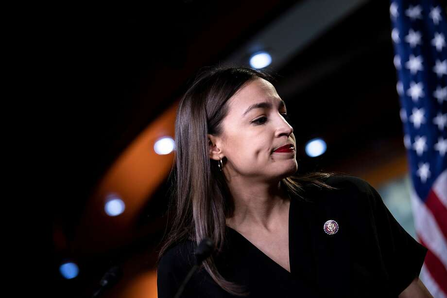 """US Representative Alexandria Ocasio-Cortez (D-NY) listens during a press conference, to address remarks made by US President Donald Trump earlier in the day, at the US Capitol in Washington, DC on July 15, 2019. - President Donald Trump stepped up his attacks on four progressive Democratic congresswomen, saying if they're not happy in the United States """"they can leave."""" Photo: Brendan Smialowski / AFP / Getty Images"""