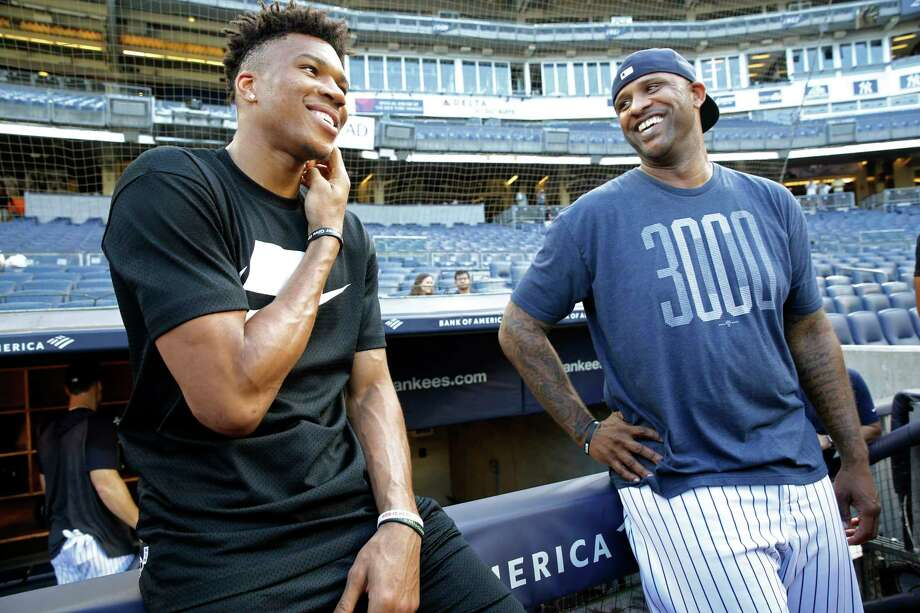 2019 NBA Most Valuable Player and Milwaukee Bucks forward Giannis Antetokounmpo, left, laughs with New York Yankees starting pitcher CC Sabathia before a baseball game between the Yankees and the Tampa Bay Rays, Monday, July 15, 2019, in New York. (AP Photo/Kathy Willens) Photo: Kathy Willens / Copyright 2019 The Associated Press. All rights reserved.