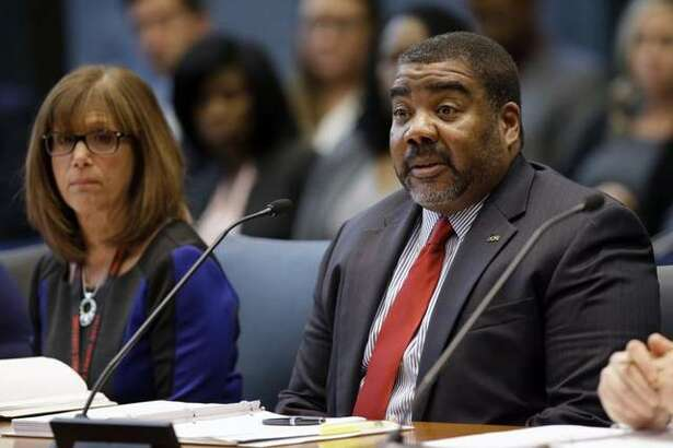 The director of the Illinois Department of Children and Family Services Marc D. Smith testifies before the House Appropriations-Human Services Committee Friday, April 26, 2019 in Chicago.