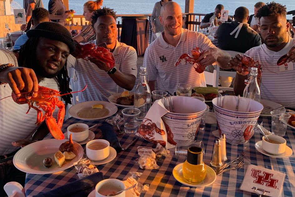 Aymiel Fleming, D'Eriq King, Dane Roy and Josh Jones at Monday's AAC clambake.