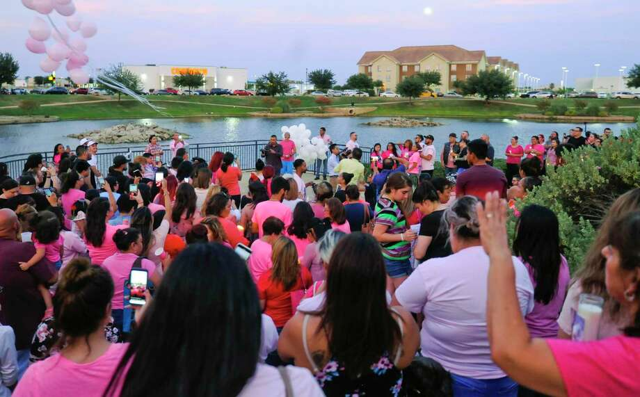 Friends of the late Myriam Camarillo gather to give their condolences to Camarillo's family at the Sames Arena Pond on Monday, July 15 during a candlelight vigil. Photo: Danny Zaragoza /Laredo Morning Times / Laredo Morning Times