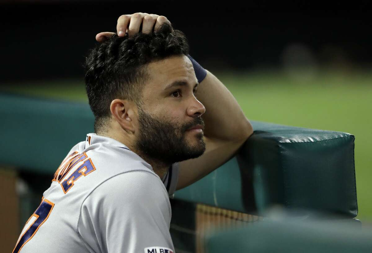 Houston Astros' Jose Altuve looks on from the dugout during a baseball game against the Los Angeles Angels Monday, July 15, 2019, in Anaheim, Calif. (AP Photo/Marcio Jose Sanchez)