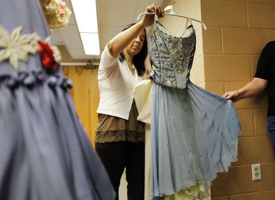 Norma Attride, New York City Ballet wardrobe supervisor for women's department, shows a redesigned ballet costume decorated with Swarovski crystals during a media tour at the Saratoga Performing Arts Center on Monday, July 15, 2019, in Saratoga Springs, N.Y. The costume will be worn by dancers for the Piano Concerto No. 2. The ballet begins their Saratoga season on Tuesday evening with the ballet Tchaikovsky and Balanchine and runs through Saturday with SPAC's New York City Ballet Gala. The ballet CoppA©lia will be performed Thursday, Friday and a matinee on Saturday. Equipment moved up to SPAC for the ballet includes more than 1,000 toe shoes, 3 miles of cable for the lighting, scenery for each ballet, a washer and dryer, and a sprung floor. An entire truck is dedicated to transporting the hundreds of ballet costumes. The full orchestra set up includes two pianos.   (Paul Buckowski/Times Union) Photo: Paul Buckowski / (Paul Buckowski/Times Union)