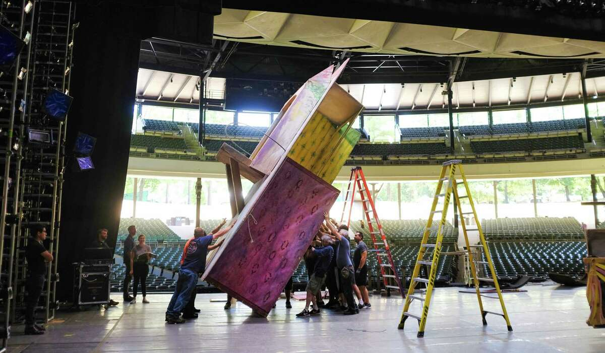 Production and backstage crews for New York City Ballet set up scenery for the ballet CoppA©lia at the Saratoga Performing Arts Center on Monday, July 15, 2019, in Saratoga Springs, N.Y. The ballet begins their Saratoga season on Tuesday evening with the ballet Tchaikovsky and Balanchine and runs through Saturday with SPAC's New York City Ballet Gala. The ballet CoppA©lia will be performed Thursday, Friday and a matinee on Saturday. Equipment moved up to SPAC for the ballet includes more than 1,000 toe shoes, 3 miles of cable for the lighting, scenery for each ballet, a washer and dryer, and a sprung floor. An entire truck is dedicated to transporting the hundreds of ballet costumes. The full orchestra set up includes two pianos. (Paul Buckowski/Times Union)