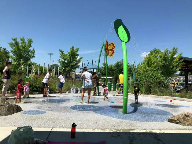 The Splash Pad in Hamden's Villano Park.  Villano Park's splash pad is located between the playground and the basketball court. There is also a covered area for parents. Photo: Ben Lambert / Hearst Connecticut Media