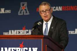 FILE - In this Aug. 4, 2015, file photo, American Athletic Conference Commissioner Mike Aresco addresses the media during an NCAA football media day in Newport, R.I. The AAC gathers for its media day, but hanging over the start of the season is Big 12 expansion. There is a chance the AAC could be lose a member or two (or three or four) when the Big 12 decides to add schools. (AP Photo/Stew Milne, File)