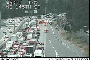 All northbound lanes of I-5 were blocked Tuesday morning after a hit-and-run crash involving three vehicles and a semi-trailer tractor.