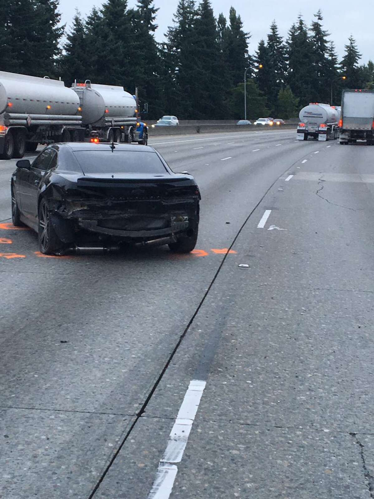 A suspected DUI driver rear-ended a Chevrolet Camaro on northbound Interstate 5 in Shoreline early Tuesday morning before he crashed into a semi-trailer tractor, seen on the left of this photo.