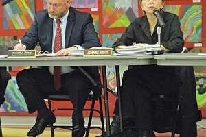 Haddam-Killingworth Schools Superintendent Howard J. Thiery, left, and Board of Education Chairwoman Joanne Nesti attend a school board meeting in February.