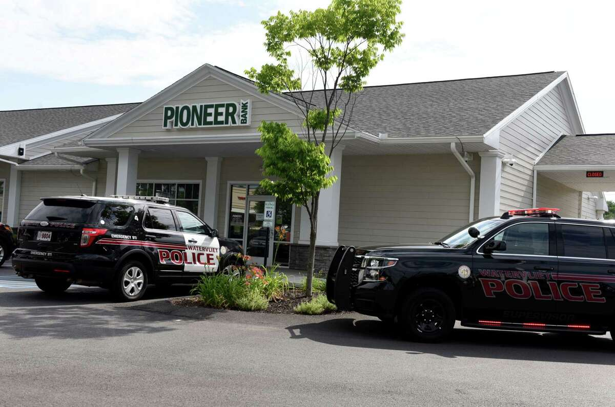 Police respond to a robbery at the Pioneer Savings Bank on Tuesday morning, July 16, 2019, on Second Avenue in Watervliet, N.Y. (Will Waldron/Times Union)