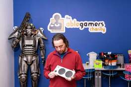 Mark Barlet, founder and executive director of AbleGamers, holds modified video game controller at the AbleGamers headquarters in Harpers Ferry, W.Va. Although some worry that video games can be isolating and addictive, Barlet contends that gaming is a lifeline for the disabled and enhances their quality of life.