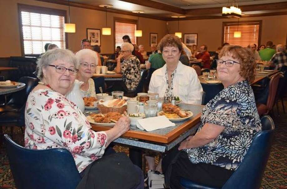 Mary Harris, of Godfrey, second from right, and members of her family enjoy the All-Star Restaurant Week special at Castelli's at 255.