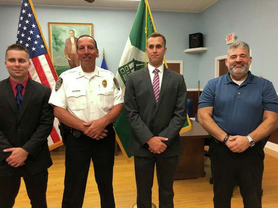 New Milford swore in two new police officers on July 15, 2019. From left to right are Officer Nick Ryan, Chief Spencer Cerruto, Officer Chad Stephen and Mayor Pete Bass. Photo: Contributed Photo / Contributed Photo / The News-Times Contributed