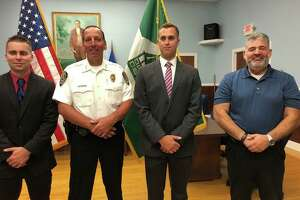New Milford swore in two new police officers on July 15, 2019. From left to right are Officer Nick Ryan, Chief Spencer Cerruto, Officer Chad Stephen and Mayor Pete Bass.