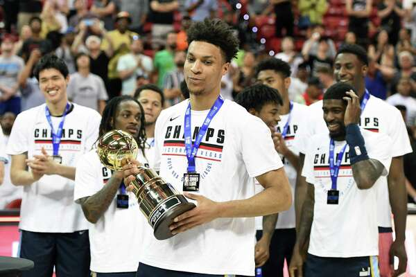 LAS VEGAS, NEVADA - JULY 15: Brandon Clarke #15 of the Memphis Grizzlies holds the championship game MVP trophy after the team's 95-92 victory over the Minnesota Timberwolves to win the championship game of the 2019 NBA Summer League at the Thomas & Mack Center on July 15, 2019 in Las Vegas, Nevada. Clarke was also awarded the 2019 NBA Las Vegas Summer League MVP trophy before the game. NOTE TO USER: User expressly acknowledges and agrees that, by downloading and or using this photograph, User is consenting to the terms and conditions of the Getty Images License Agreement.