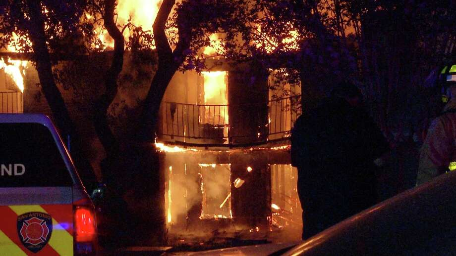 Families were displaced after a two-alarm fire destroyed their apartments on the city's North Side late Monday night, San Antonio firefighters said.  Photo: Ken Branca