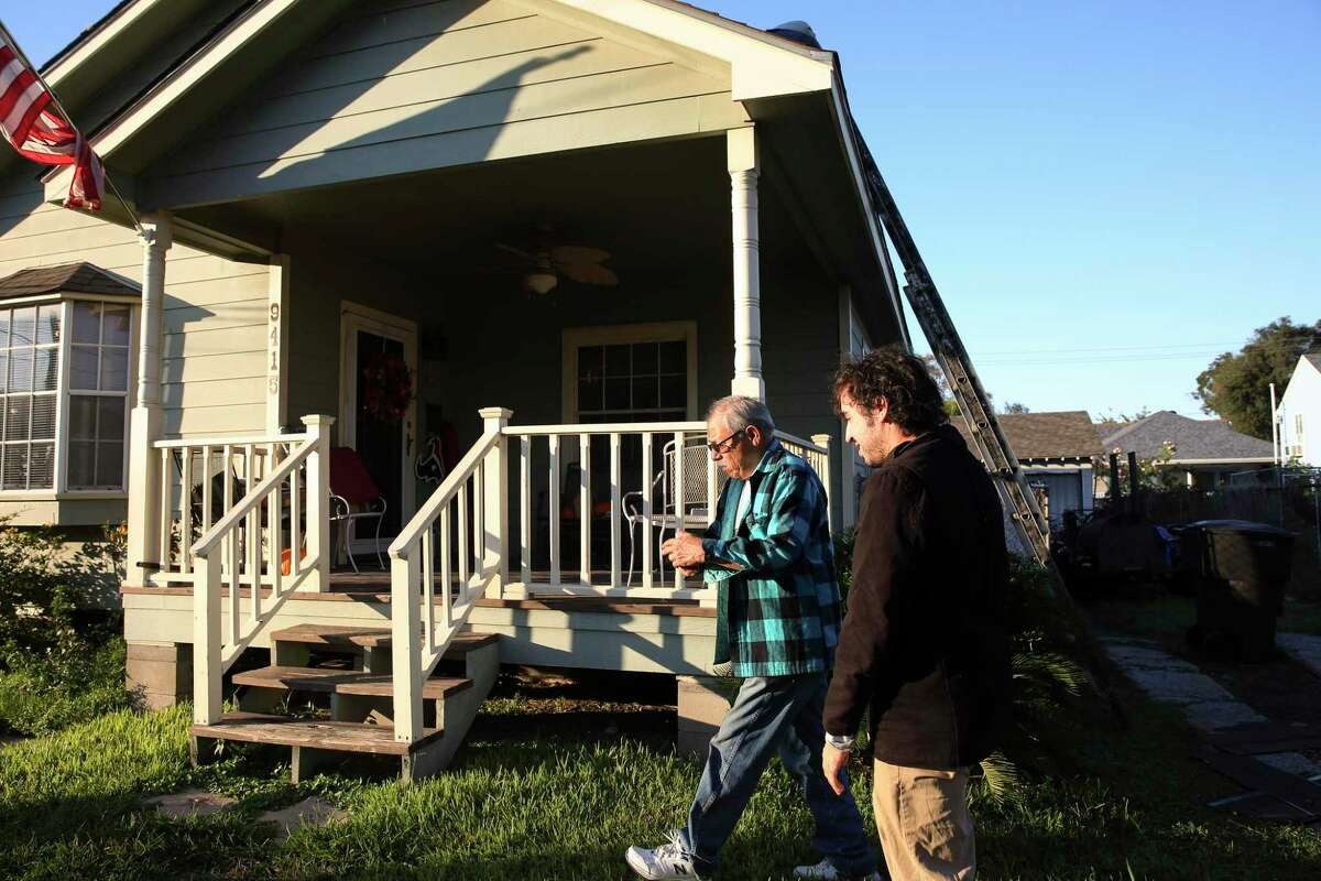 Texas A&M toxilogy doctoral student Gaston Casillas, right, follows Richard Vigil to Vigil's house to collect his wristband sample that detects issues with pollution, emissions and etc...in Manchester neighborhood on Thursday, Nov. 9, 2017, in Houston. The Manchester community is one of the riskiest in terms of emissions exposure from refineries and petrochemical plants and had more incidents during Hurricane Harvey with benzene leaks. ( Yi-Chin Lee / Houston Chronicle )